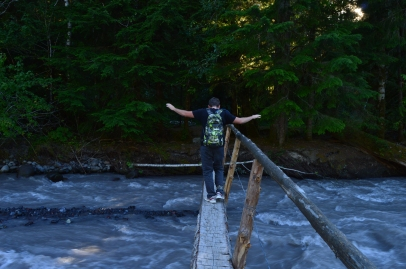 Ryan crossing a sketchy bridge on the Carbon River in Mount Rainier National Park