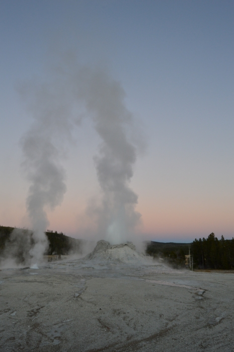 Castle Geyser letting off steam at sunset