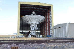 One of the radio antennas being worked on for the VLA