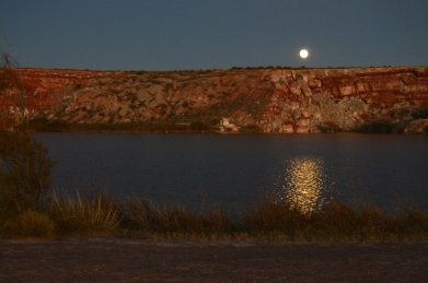 The supermoon over a bottomless lake in Bottomless Lakes State Park, New Mexico