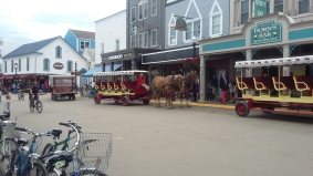 A carriage taxi prked on Main Street, Mackinac Island, Michigan