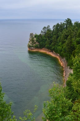 A view of the colorful sandstone cliffs and the deep cold waters of Lake Superior, Pictured Rocks National Lakeshore