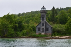 A weathered old light houe on the shores of Lake Superior