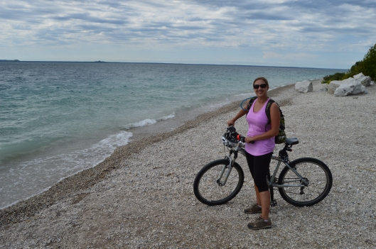 Courtney taking a break from riding around Mackinac Island on the shore of Lake Huron