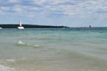 The azure blue waters of Lake Huron on the coast of Mackinac Island, Michigan