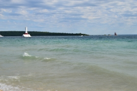 The azure blue waters of Lake Huron on the coast of Mackinac Island, Michigan
