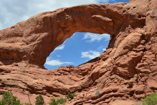 A big beautiful Arch with a blue sky and white clouds is pleasing to the soul. Arches National Park, Moab, UT
